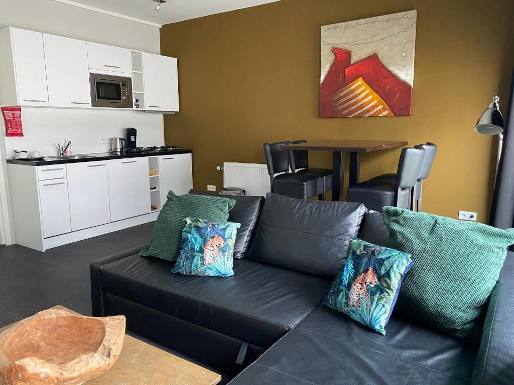 Ein Sitzbereich in der Unterkunft Hotel Zilt
