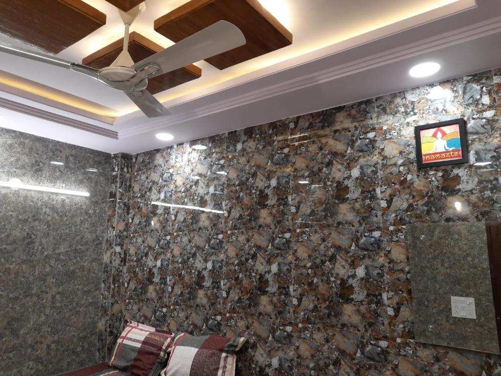 Cream location posh lajpat nagar luxury room with attached kitchen and washroom