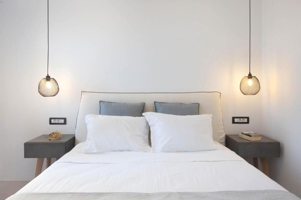Ένα ή περισσότερα κρεβάτια σε δωμάτιο στο Kouros Village