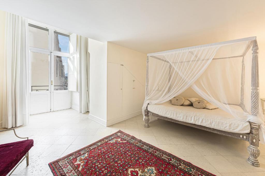 Letto o letti in una camera di Casa Bormioli - Maison de Charme
