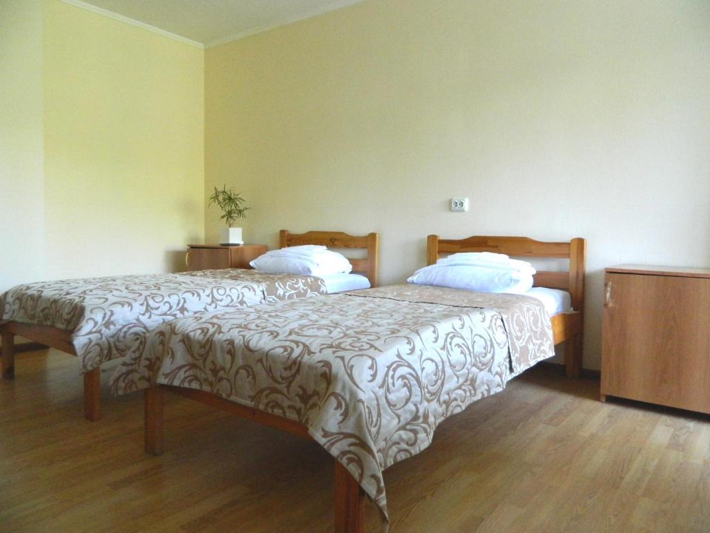 Кровать или кровати в номере Отель Академия