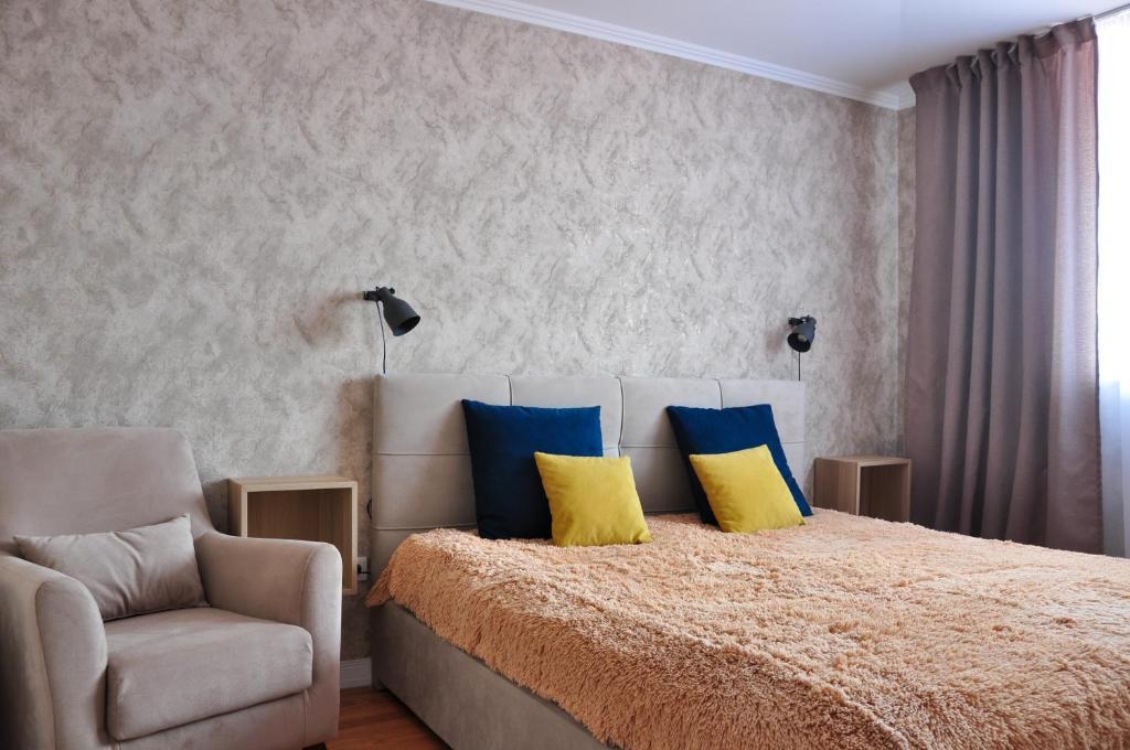 A bed or beds in a room at Двухкомнатная квартира на ул Первомайской 23