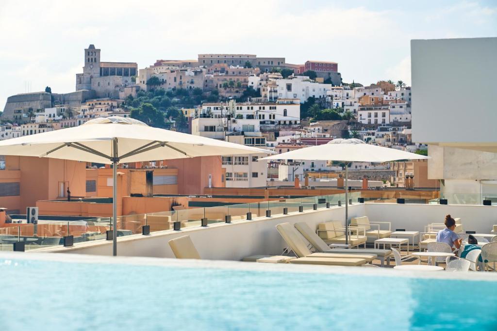 The swimming pool at or near El Puerto Ibiza Hotel Spa