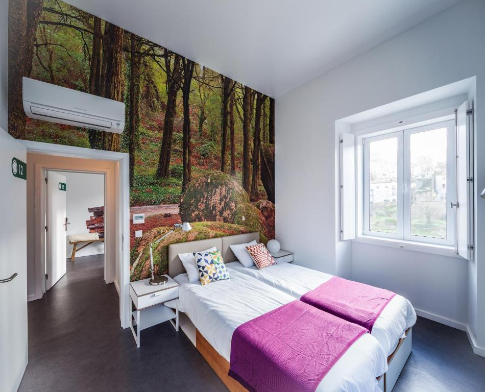 A bed or beds in a room at Moon Hill Hostel