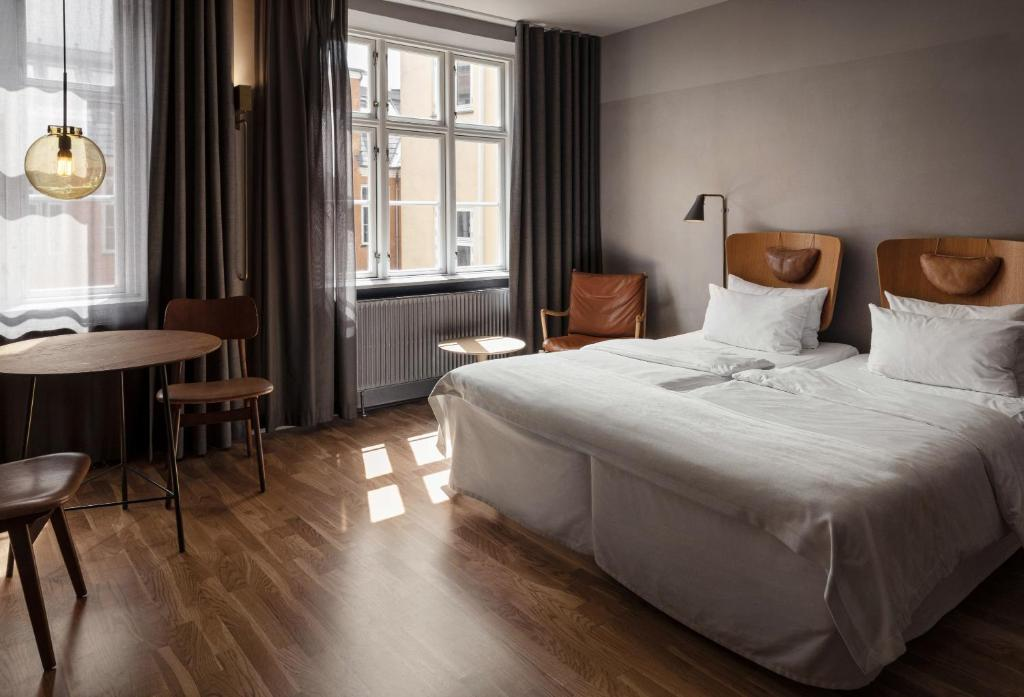 A bed or beds in a room at Hotel SP34 by Brøchner Hotels