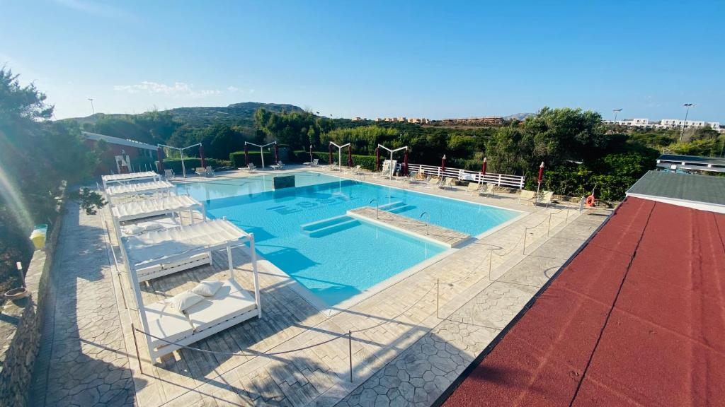 The swimming pool at or near Club Esse Sporting