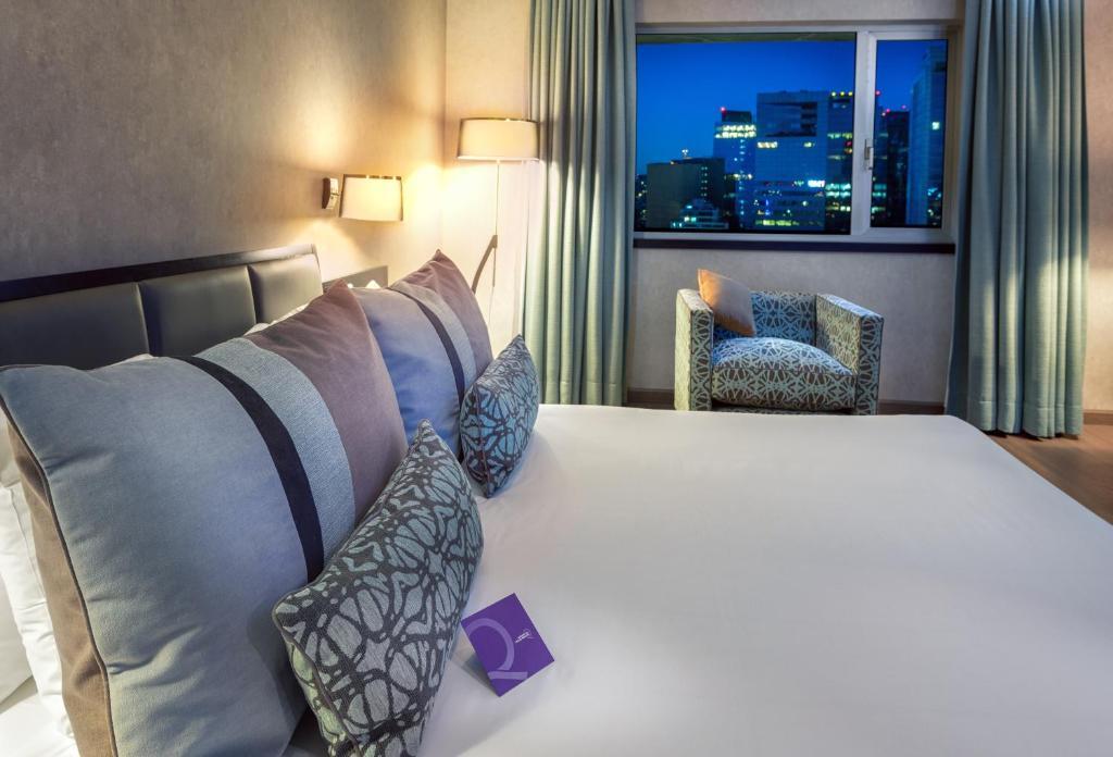Cama o camas de una habitación en Mercure Santiago Centro