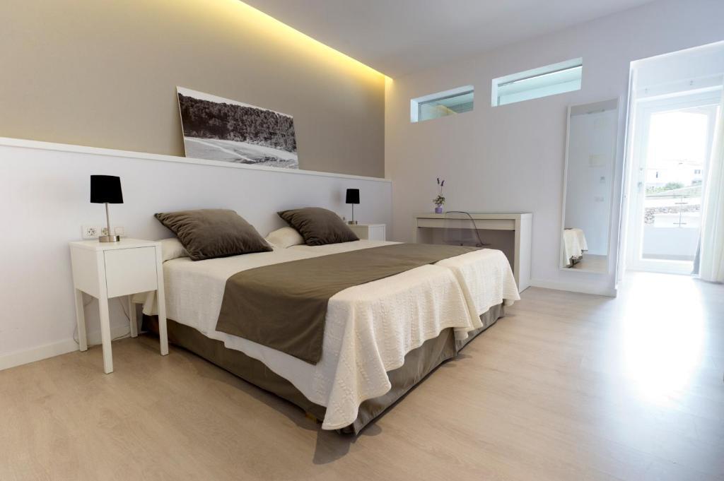 Cama o camas de una habitación en Hostal La Palma