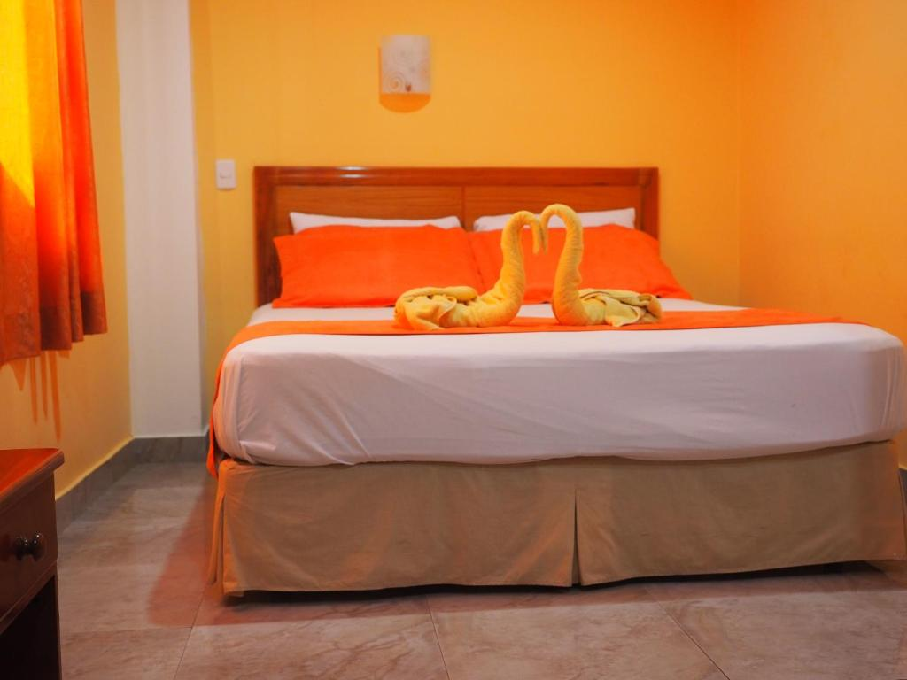 A bed or beds in a room at Hotel España