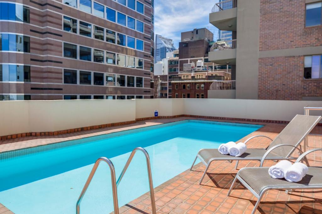 The swimming pool at or near Metro Apartments on King