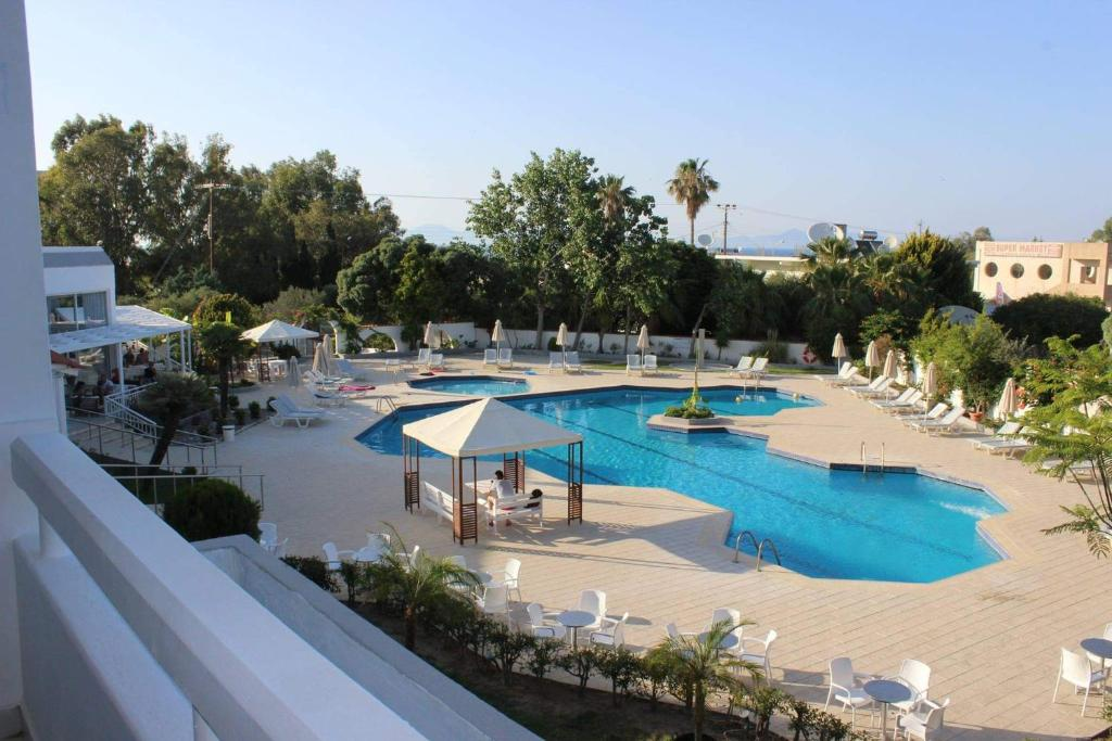 A view of the pool at Happy Days Hotel or nearby