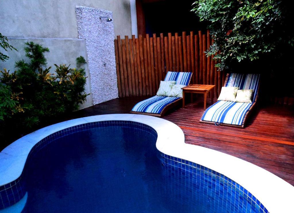 The swimming pool at or close to Pousada Rosa dos Ventos