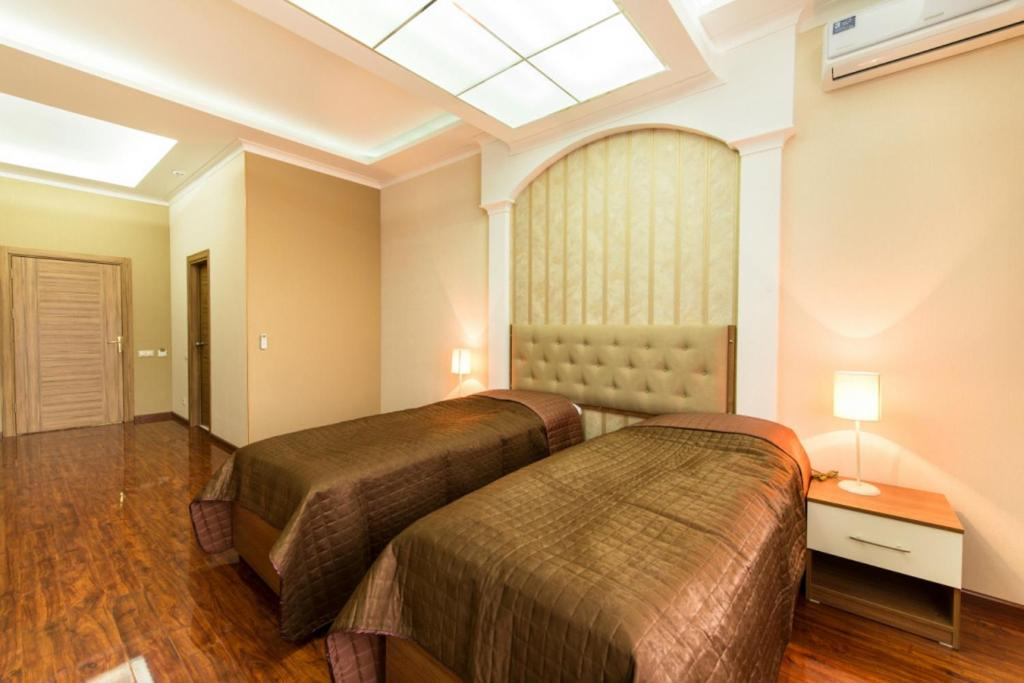 A bed or beds in a room at Alva Donna Hotel