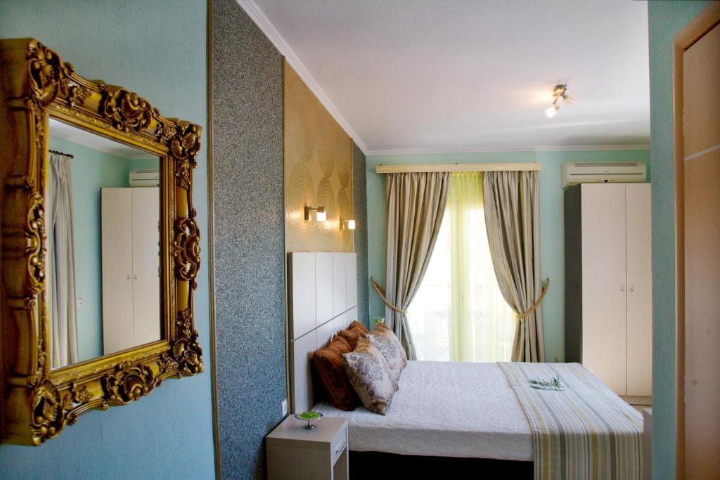 Ένα ή περισσότερα κρεβάτια σε δωμάτιο στο Kaplanis House