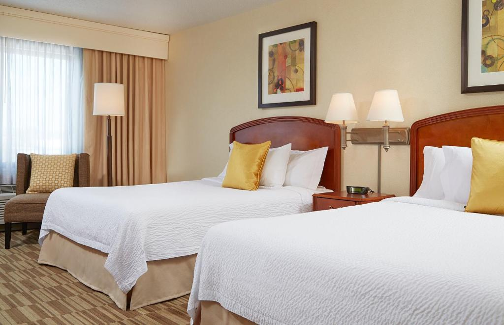 A bed or beds in a room at Courtyard Boston Natick
