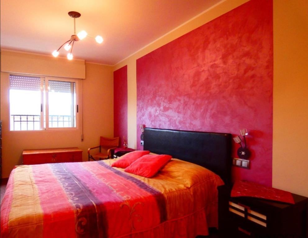 Cama o camas de una habitación en Apartamento con encanto bien equipado