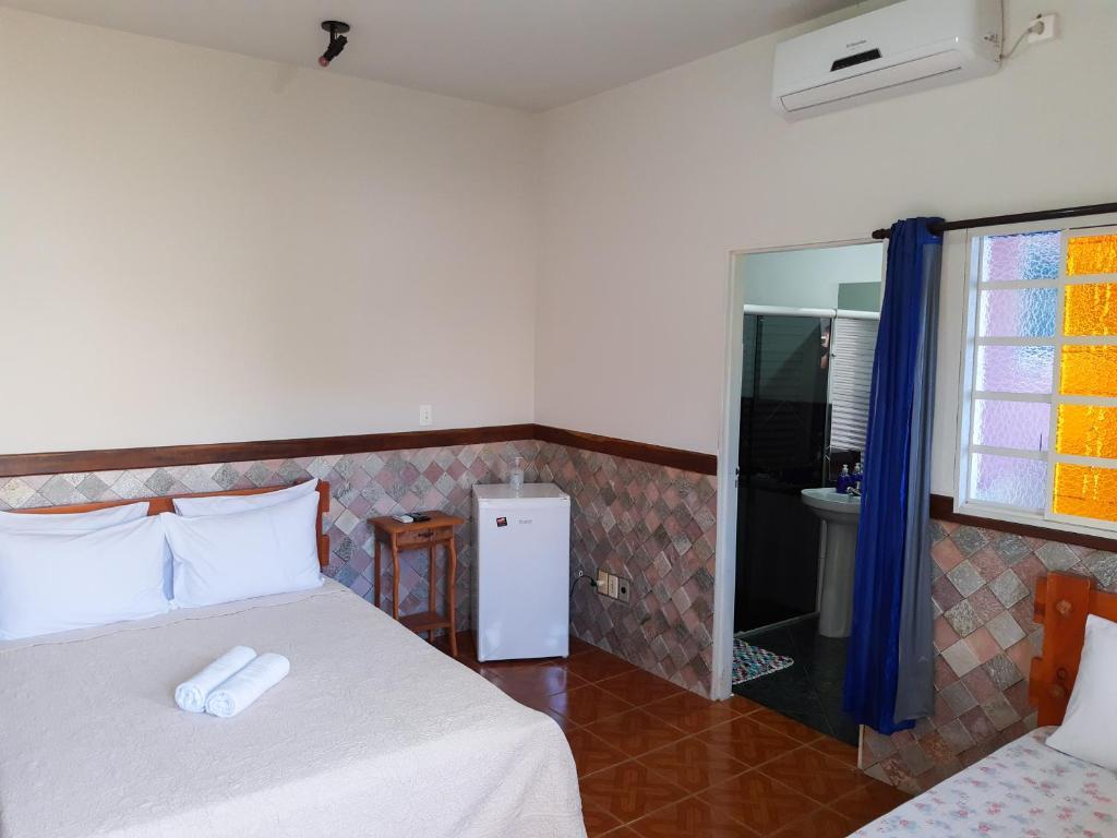 Cama o camas de una habitación en Suítes Meia Lua
