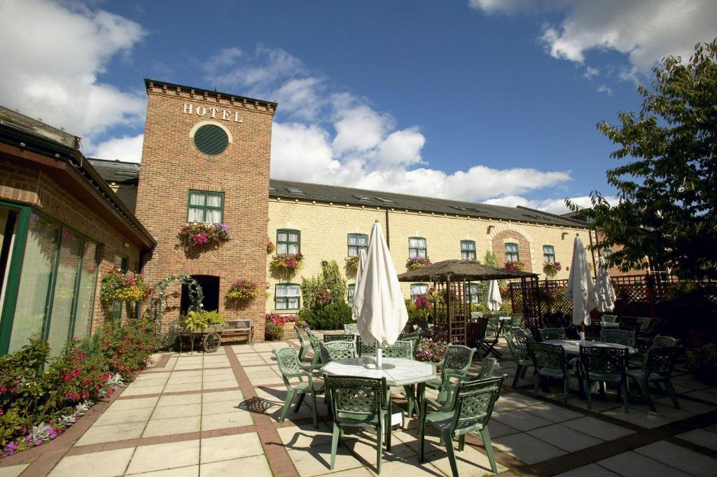 A restaurant or other place to eat at Corn Mill Lodge Hotel