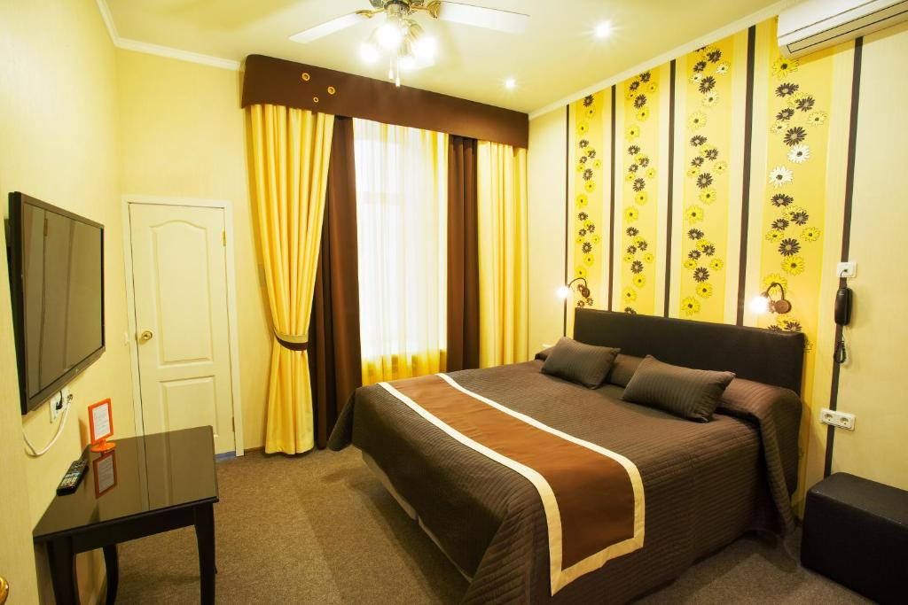 Кровать или кровати в номере Невский Контур