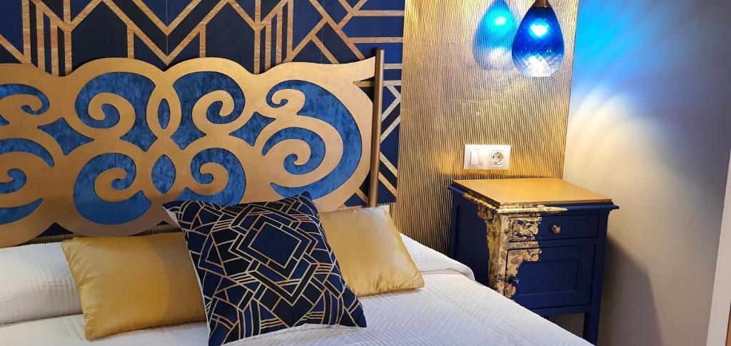 Cama o camas de una habitación en Hosteria Villa de Castro