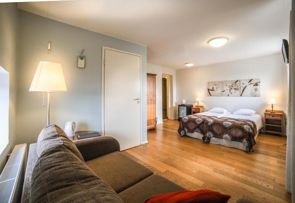 Säng eller sängar i ett rum på Jugend Home Hotel