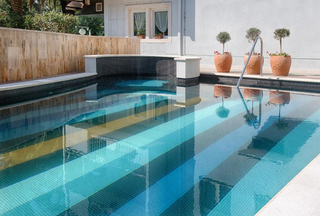 The swimming pool at or near Boban Luxury Suites