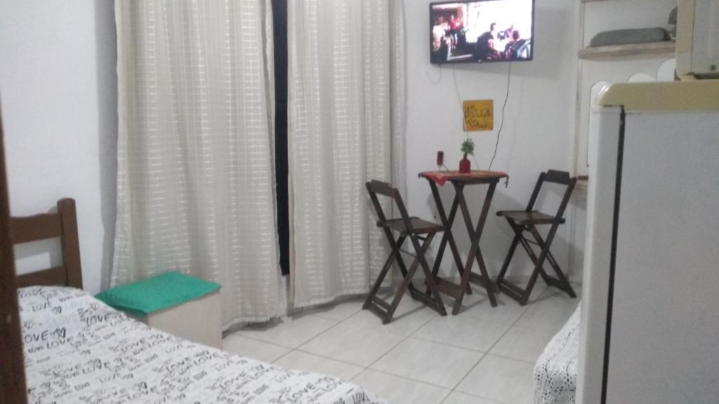 A television and/or entertainment centre at Suite dos anjos