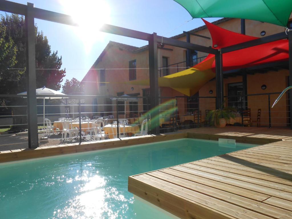 The swimming pool at or near La Petite Ecole