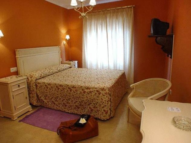 Cama o camas de una habitación en Hostal Emilia