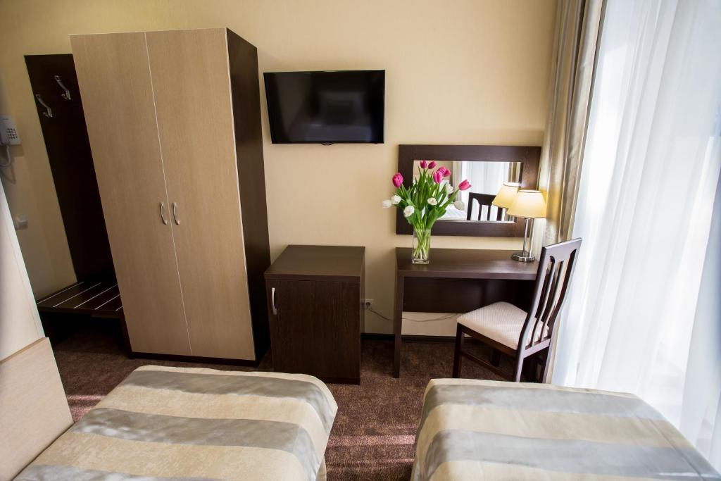 Телевизор и/или развлекательный центр в Парк Хаус Отель