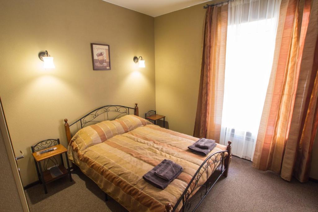Кровать или кровати в номере Кофе с Молоком на Фонтанке