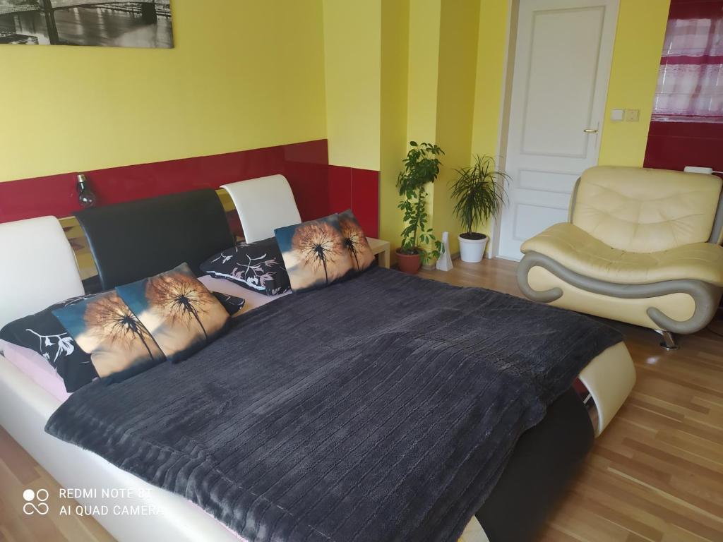 Postel nebo postele na pokoji v ubytování Ubytování U Minoritů