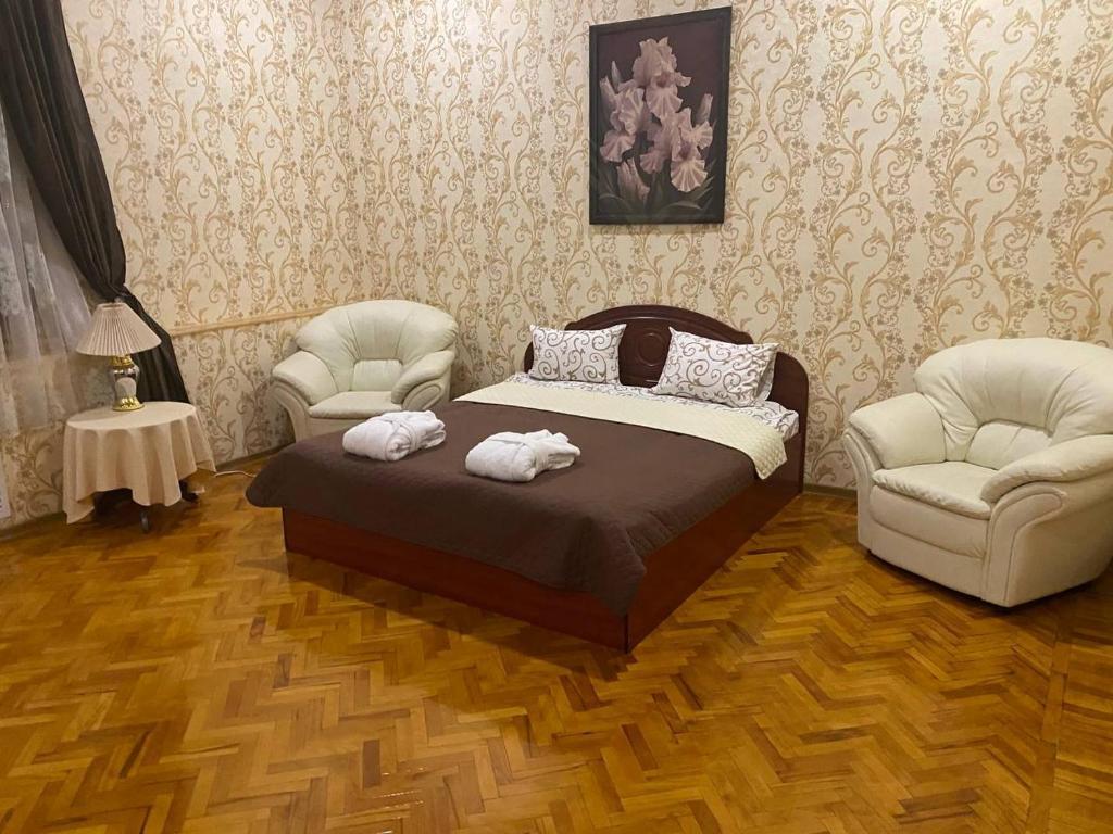 Кровать или кровати в номере Мини отель, гостиный двор «Байкал»