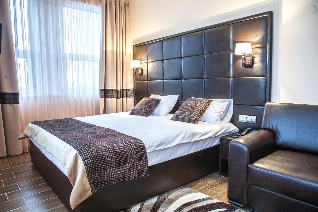 Кровать или кровати в номере Мотель Руслан