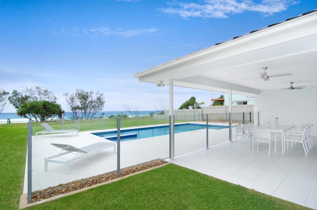 The swimming pool at or near Sentosa on Tugun - Beachfront 5 Bedroom