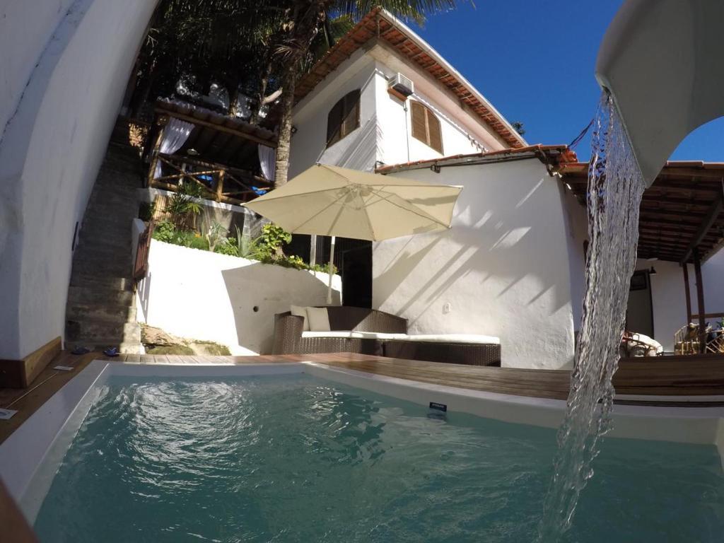 The swimming pool at or close to Casa Vila Mar - Inn Prainha