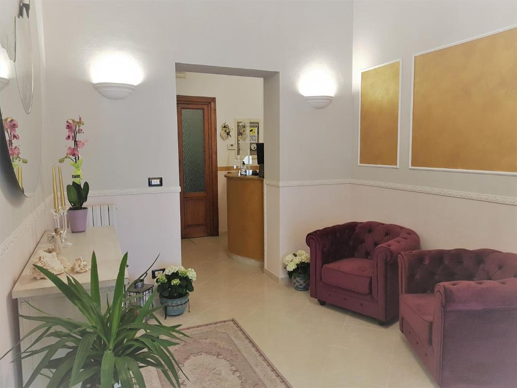 The lobby or reception area at Hotel Albachiara