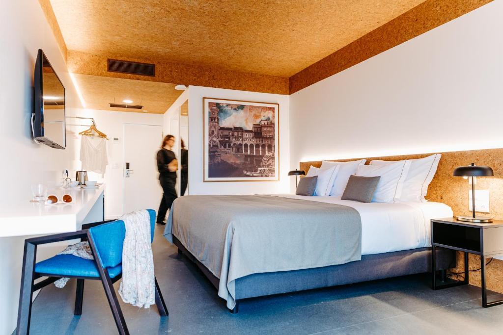 Uma cama ou camas num quarto em Canadiano Urban Nature Hotel