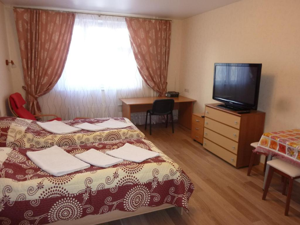 A bed or beds in a room at Apartments Krasnogorsk Expo