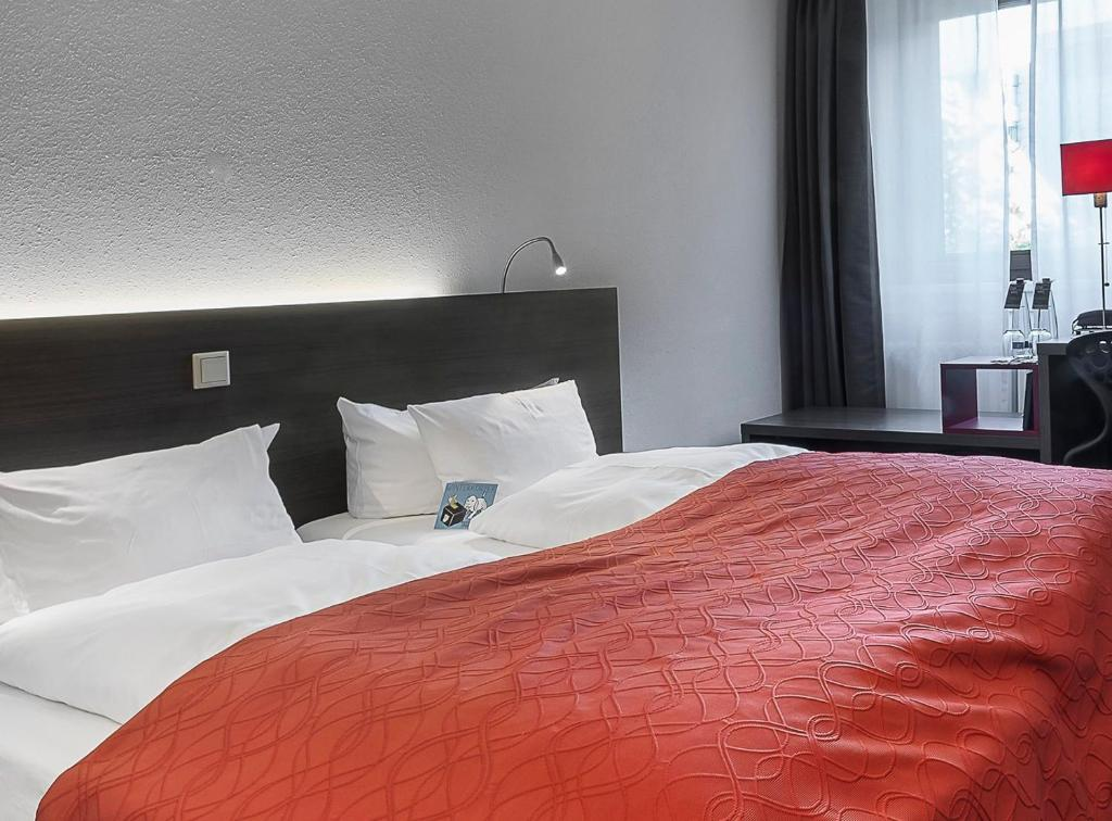 A bed or beds in a room at Art & Business Hotel