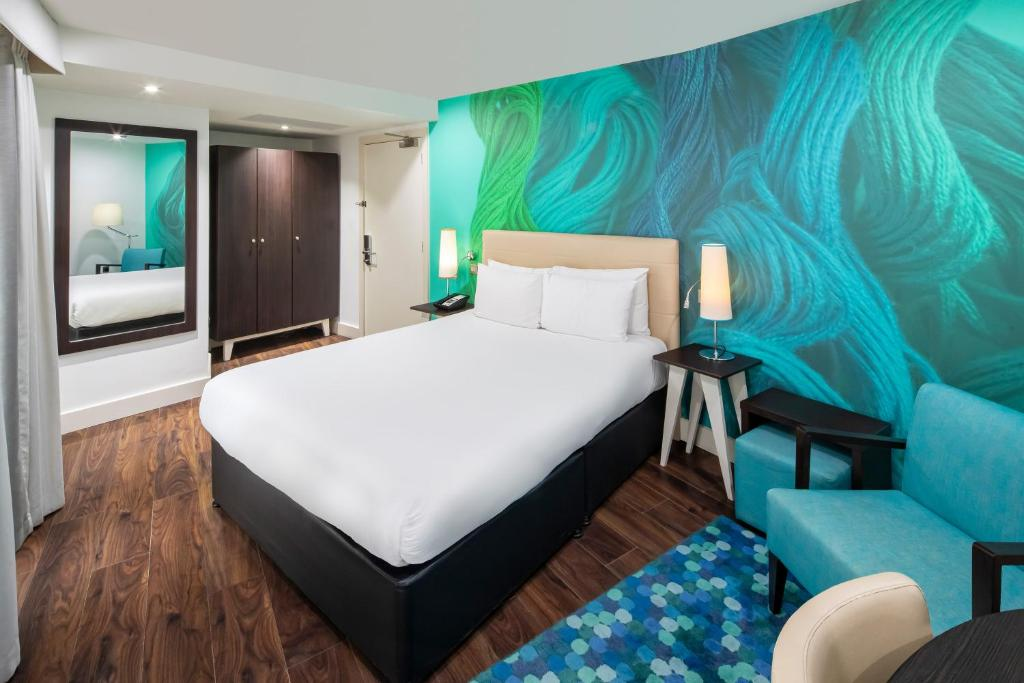A bed or beds in a room at Hotel Indigo Liverpool, an IHG hotel