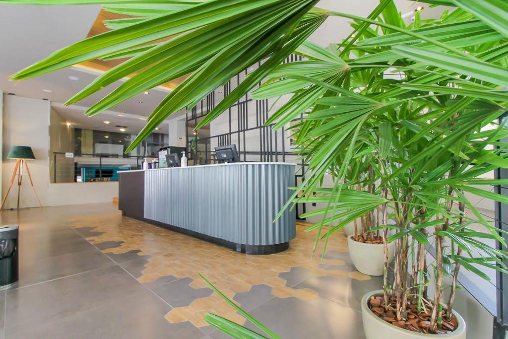 The lobby or reception area at Coral Trade - Hospitais Puc RS e Clínicas - Pet Friendly
