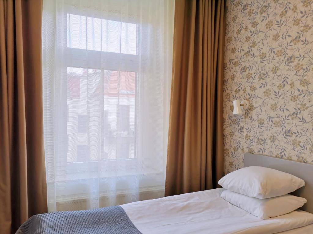 Säng eller sängar i ett rum på Hotel Lorensberg - Sure Hotel Collection by Best Western