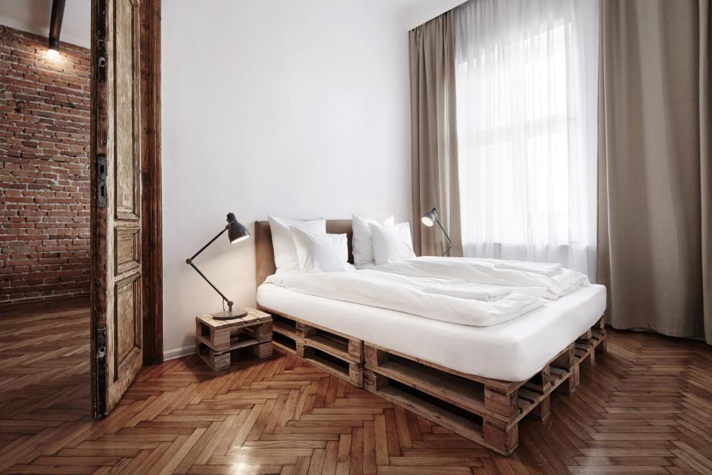 Łóżko lub łóżka w pokoju w obiekcie Laiko Apartments