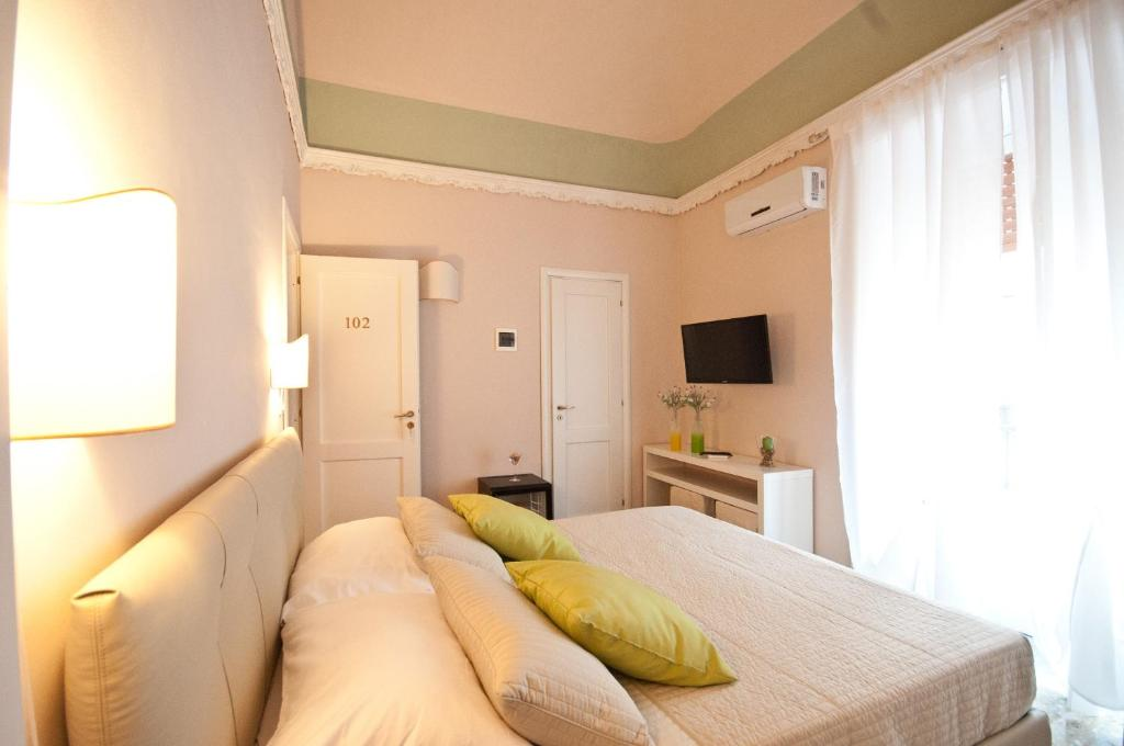 Letto o letti in una camera di Suite Barocca