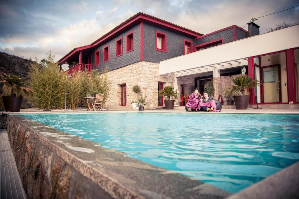 The swimming pool at or near Quinta dos Padres Santos, Agroturismo & Spa