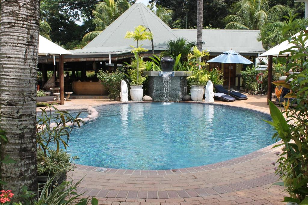 The swimming pool at or near Hotel Chateau St Cloud