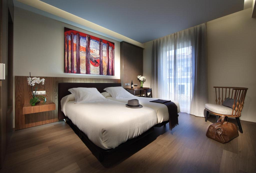 Cama o camas de una habitación en Hotel Abades Recogidas