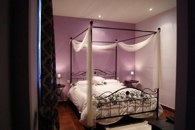 Cama o camas de una habitación en Hotel Rural el Linaje de Los Cinco Sombreros