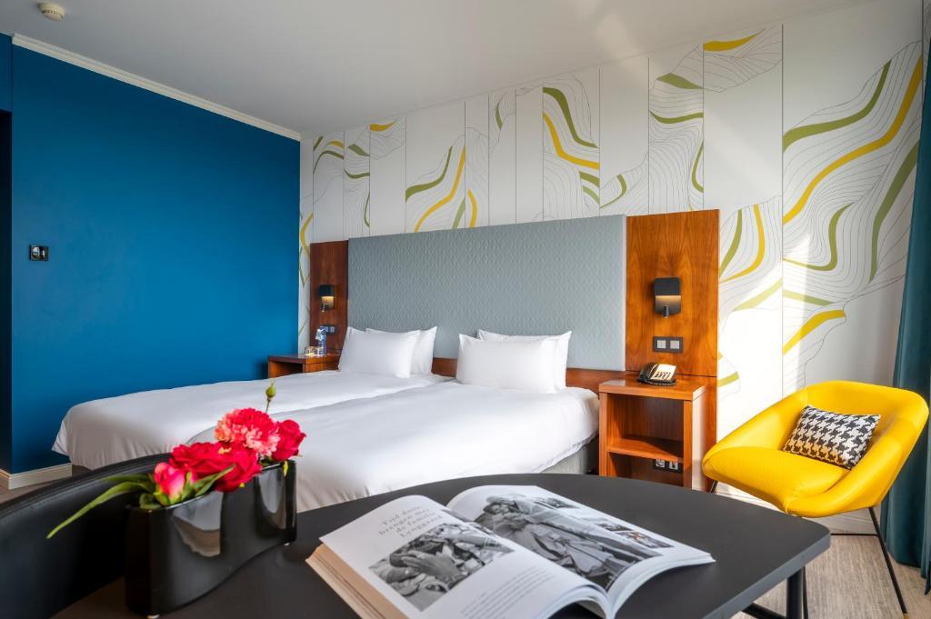 Ein Bett oder Betten in einem Zimmer der Unterkunft Mercure Antwerp City Centre